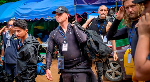 Foreign divers head to Tham Luang Nang Non cave during the rescue operation