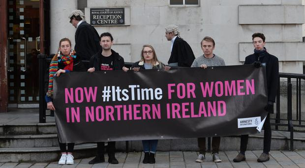 Pro-choice protesters outside Belfast High Court, where Sarah Ewart's case is being heard