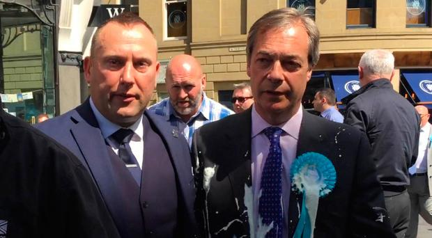 Nigel Farage (right) after being hit by a milkshake during a walkabout this week in Newcastle