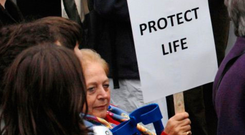 A protester displays an anti-abortion placard