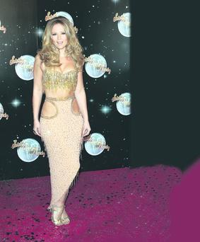 Kimberley Walsh, in yet another flesh-flashing dress, is falling flat in style stakes