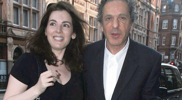 Heated row: Charles Saatchi was pictured grabbing wife Nigella Lawson by the throat