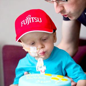 Oscar Knox, who is battling high-risk neuroblastoma, pictured celebrating his fourth birthday