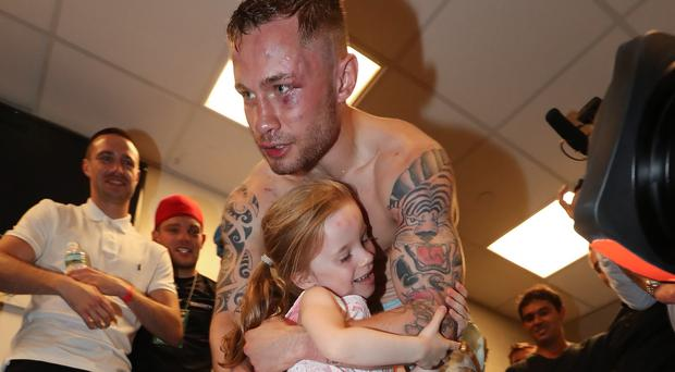 Daddy's girl: Carl Frampton gets a hug from his daughter Carla