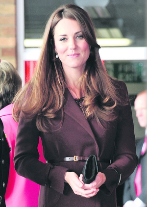 GRIMSBY, ENGLAND - MARCH 05:  Catherine, Duchess of Cambridge visits Humberside Fire and Rescue Peaks Lane Fire Station on March 5, 2013 in Grimsby, England.  (Photo Bruce Adams  - WPA Pool/Getty Images)