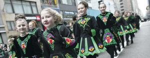 Going green: dancers on Fifth Avenue, New York