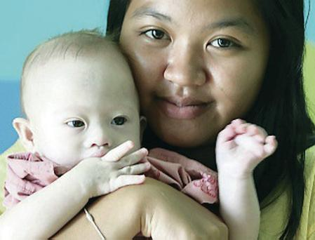 Uncertain future: surrogate mother Pattaramon Chanbua with baby son Gammy in Thailand