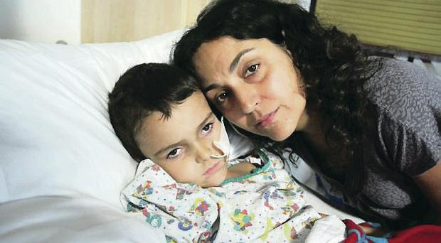 Mother's anguish: Naghmeh King, pictured with Ashya, is in custody in Spain with her husband Brett