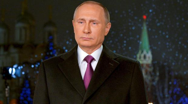 Shirtless icon: Vladimir Putin has released a new calendar for 2016