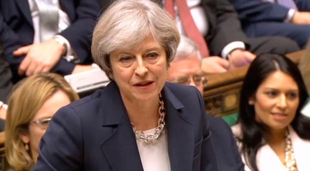 Getting out: Prime Minister Theresa May has announced she will trigger Article 50 on March 29