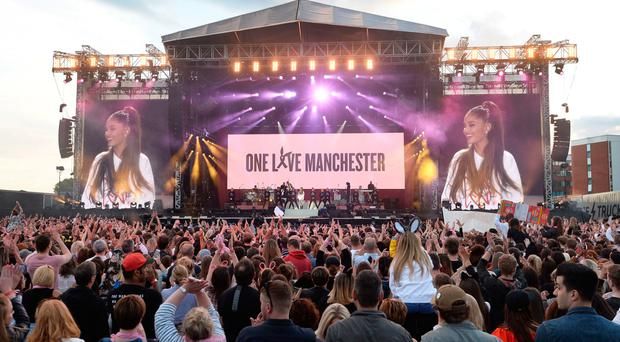 Standing up: Ariana Grande on stage at the One Love Manchester concert