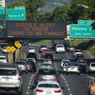 Bombed out: a sign on the H-1 freeway in Honolulu informs people that there was no missile threat