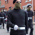 Masked men at a funeral in Derry