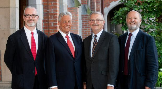 Former DUP leader Peter Robinson at Queen's University Belfast with (from left) Professor Richard English, Professor James McElnay and Professor John Brewe