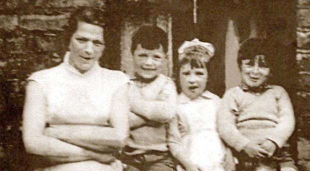 IRA murder victim Jean McConville with her family