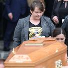 Sara Canning walks behind the coffin of her partner Lyra McKee