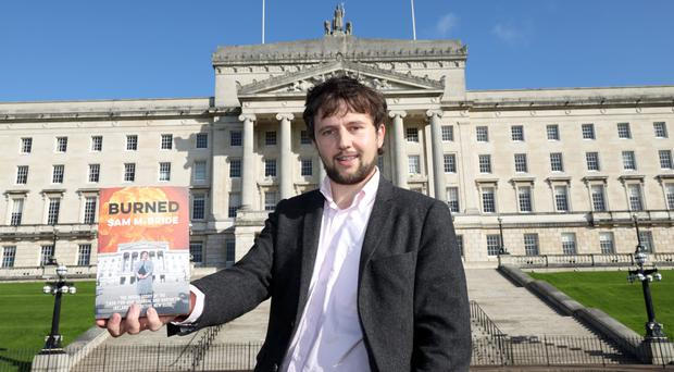 Reporter and author Sam McBride with his new book Burned outside Stormont