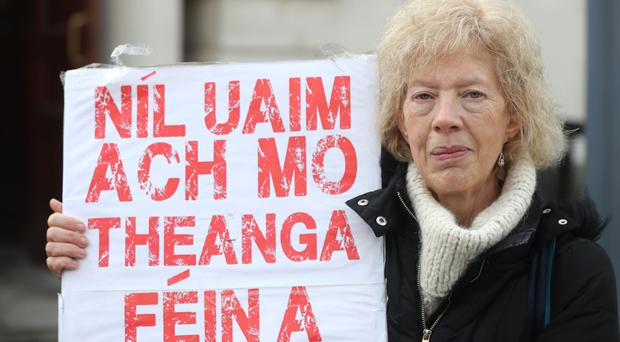 Janet Muller, chief executive officer of Pobal, joins Irish language campaigners at a protest over Stormont's failure to introduce an Irish language strategy