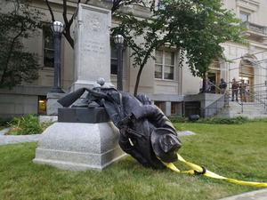 A toppled Confederate statue lies on the ground in Durham, USA, last week