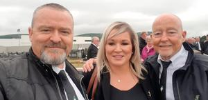 Michelle O'Neill poses for a selfie with two mourners at Bobby Storey's funeral. Photo: PA