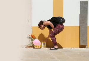 A tourist looks at a tribute to Madeleine McCann, close to where the girl went missing