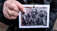 Holocaust survivor and former prisoner of the Nazi death camp Auschwitz-Birkenau, Miriam Friedman Ziegler, shows a historical picture of her and other prisoners in Oswiecim on January 26, 2020, one day before the 75th anniversary of its liberation