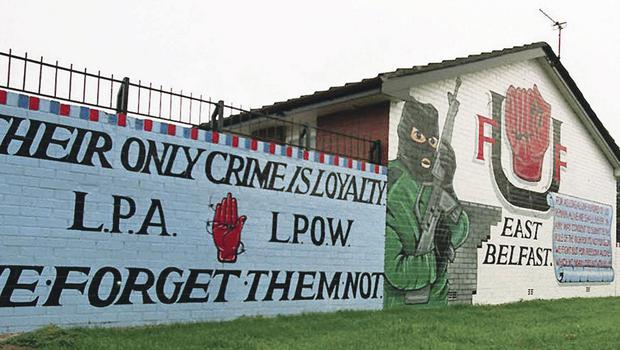 Born identity: The UDA mural in east Belfast where many young Protestants say pride in the British Army, and anger at flag protests, have reinforced their sense of Britishness