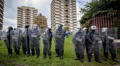 Police during the disorder over the New Lodge bonfire