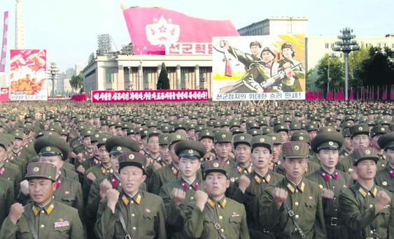 No joke: massed ranks of fist-pumping North Korean soldiers on parade