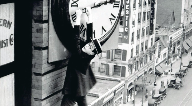 Harold Lloyd hangs from a clock in the 1923 film Safety Last
