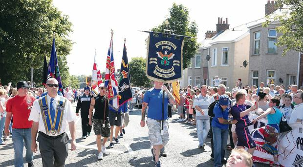 Protesters on the Woodvale Road after the Parades Commission imposed restrictions on an Orange Order parade