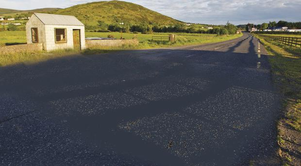 No man's land: The old Dundalk Road outside Newry. The hut on the left marks the border between north and south