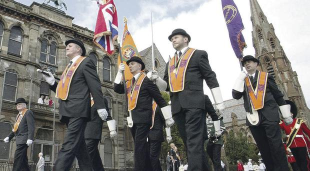 Slow progress: A Twelfth of July parade moves off from Carlisle Circus in north Belfast