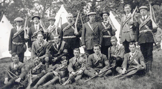 Armed and ready: The Donegal and Derry regiments of the Ulster Volunteer Force unload arms at Bangor pier
