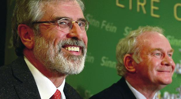 Gerry Adams and Martin McGuinness at the Press conference after Adams' release from custody