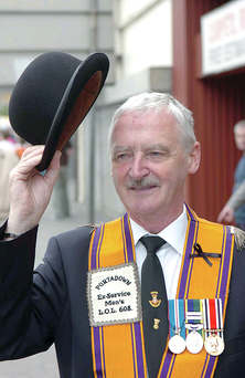 Orangeman Sam Thomspon of Portadown Ex-Service Men's LOL 608 raises his hat on the Twelfth