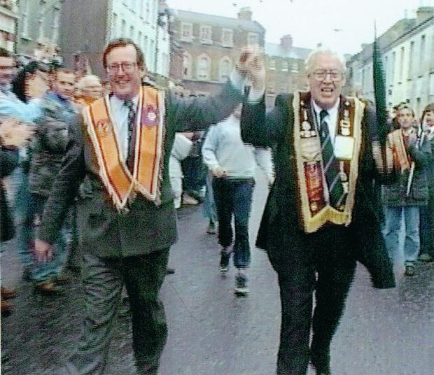David Trimble and Ian Paisley celebrate Orangemen being allowed to walk the Garvaghy Road