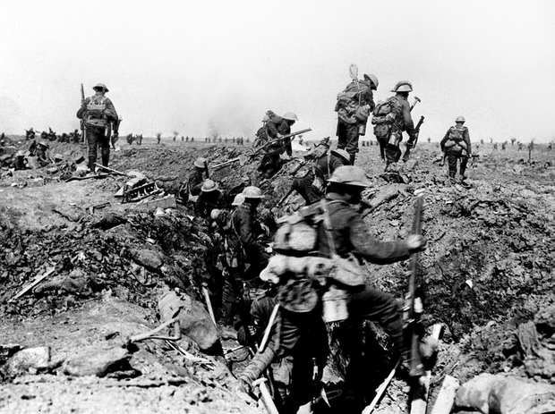British troops negotiating a trench as they go forward in support of an attack on the village of Morval during the Battle of the Somme