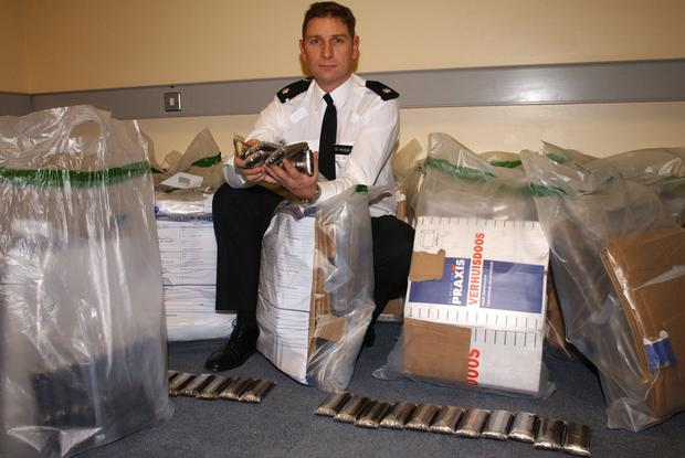 Former Chief Superintendant Gary White with £1.5m of drugs seized in Belfast raid