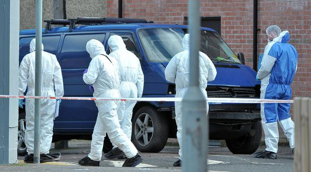 Forensic officers at the scene of the blast.