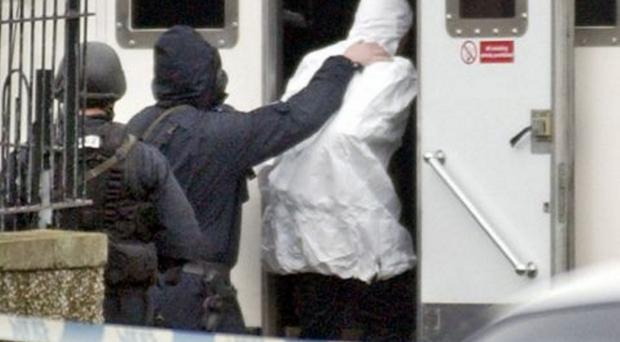 Detained: Intelligence is helping police round up terror suspects, securing convictions, however, is proving difficult