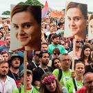 Festival-goers hold placards to remember Jo Cox at an event on the Park stage during the Glastonbury Festival