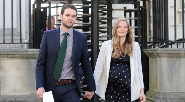 Daniel McArthur and wife Amy outside court yesterday