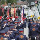Bandsmen returning along the Crumlin Road last month, bringing to an end a long-running dispute
