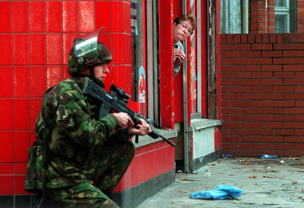 On guard: a soldier during Operation Banner guarding a north Belfast peace wall