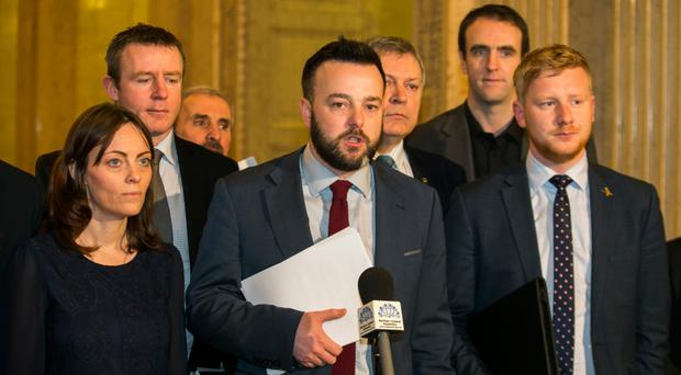 SDLP leader Colum Eastwood and party members after they staged a boycott at Stormont
