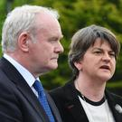 Martin McGuinness with Arlene Foster in May last year