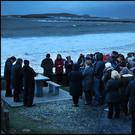 A evening prayer vigil held for the familes and crew of Rescue 116 with Blackrock Lighthouse in the distance near Blacksod, Co Mayo