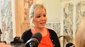 Sinn Féin leader in the North, Michelle O'Neill, speaks to the media after signing a book of condolence at Belfast City Hall which was opened up for the victims of the bomb attack in Manchester