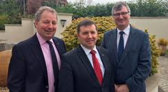 UUP leader Robin Swann (centre) with party colleagues Danny Kinahan (left) and Tom Elliott